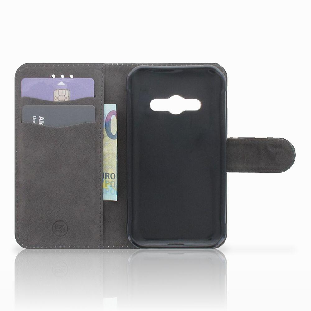 Samsung Galaxy Xcover 3 | Xcover 3 VE Telefoonhoesje met Pasjes Koeienvlekken
